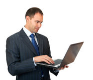 Businessman with laptop. Royalty Free Stock Images