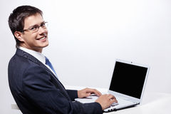 Businessman with a laptop Royalty Free Stock Photography