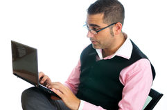 Businessman with laptop. A businessman with a little computer Stock Photos