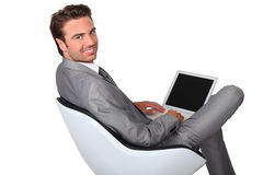 Businessman with laptop Royalty Free Stock Photo