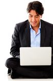 Businessman with a laptop Royalty Free Stock Photos