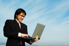 Businessman and laptop Royalty Free Stock Photos