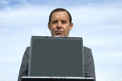 Businessman and laptop. With empty screen stock images