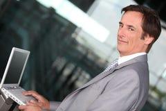 Businessman on laptop Stock Photo
