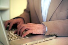 Businessman and laptop Royalty Free Stock Photography
