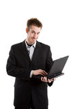 Businessman and laptop Royalty Free Stock Images