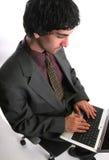 Businessman and laptop Stock Photos