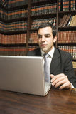 Businessman on Laptop Stock Images