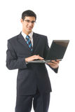 Businessman with laptop Royalty Free Stock Photos