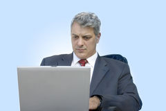 Businessman with laptop. Businessman working on his laptop (focus is on the laptop Royalty Free Stock Images