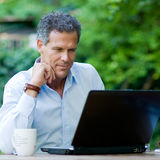 Businessman on laptop Royalty Free Stock Image
