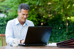 Businessman on laptop Royalty Free Stock Photo