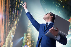 The businessman with laptop against the building Royalty Free Stock Photography