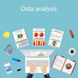 Businessman with laptop analyzes data. Stock Photos