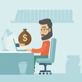 Businessman and laptop. Businessman with beard wearing glasses sitting infront of his table working at a laptop searching and browsing with bag of money on hand Stock Photography