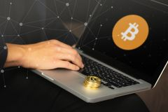 Businessman on laptop with bitcoin coins royalty free stock photo