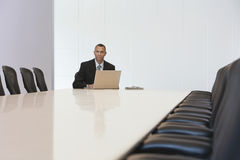 Businessman With Laptop In Board Room Royalty Free Stock Image