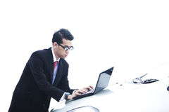 Businessman with laptop on the car Stock Images