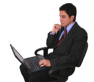 Businessman laptop and chair. Businessman working without a desk with the laptop on his legs Stock Images