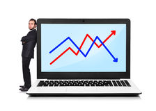 Businessman and laptop with chart Royalty Free Stock Images