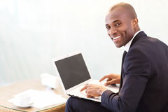 Businessman with laptop. Royalty Free Stock Photos