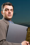 Businessman with laptop close up Stock Photo