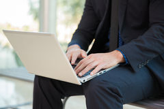 Businessman with a laptop Stock Photography