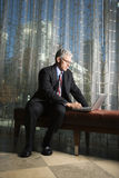 Businessman with Laptop Computer. Royalty Free Stock Images