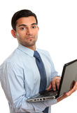 Businessman with laptop computer Stock Image
