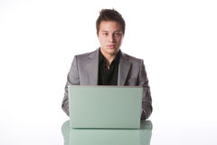 Businessman with a laptop computer Stock Photo