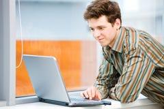 Businessman with laptop computer Stock Photos