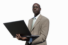 Businessman with laptop computer, cut out Stock Image