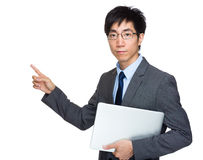 Businessman with laptop computer and finger point out Royalty Free Stock Images