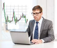 Businessman with laptop computer and forex chart Royalty Free Stock Photo