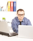 Businessman with laptop computer in office Stock Images