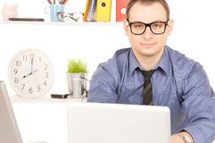 Businessman with laptop computer in office Royalty Free Stock Image