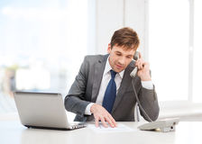 Businessman with laptop computer and phone Stock Photos