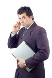Businessman with a laptop computer talking on a cell phone. Against white background Stock Photography