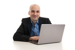 Businessman with laptop computer Royalty Free Stock Image