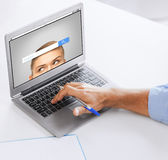 Businessman with laptop computer working at office Stock Images