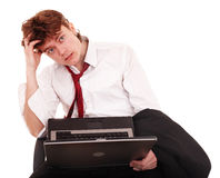 Businessman with laptop in crisis. Royalty Free Stock Photo