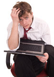 Businessman with laptop in crisis. Stock Photo