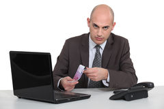 Businessman with a laptop Stock Images