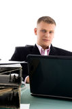 Businessman with laptop and files Royalty Free Stock Photography