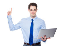 Businessman with laptop and finger point up Royalty Free Stock Photo