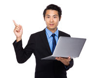 Businessman with laptop and finger point up Royalty Free Stock Images