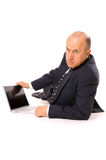 Businessman with laptop on the floor. Isolated on white Royalty Free Stock Photography