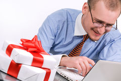 Businessman with laptop and gift box Stock Image