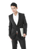 Businessman with a laptop in hand Stock Photography
