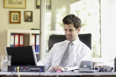 Businessman with laptop Stock Photo